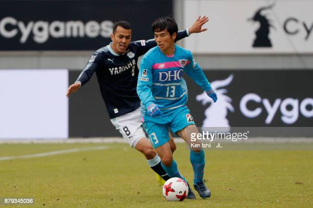 Yuzo Kobayashi of Sagan Tosu controls the ball under pressure of Fozil Musaev of Jubilo Iwata during the JLeague J1 match between Sagan Tosu and...