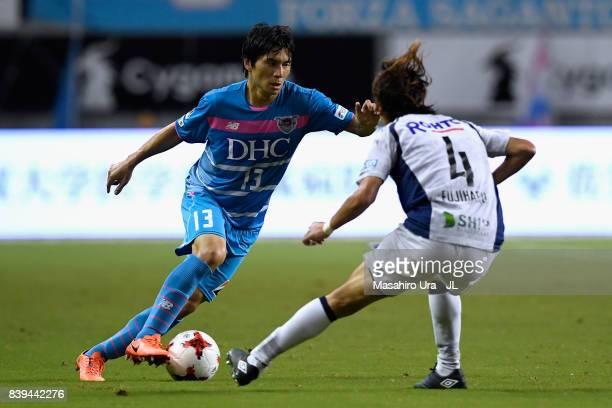 Yuzo Kobayashi of Sagan Tosu takes on Hiroki Fujiharu of Gamba Osaka during the JLeague J1 match between Sagan Tosu and Gamba Osaka at Best Amenity...