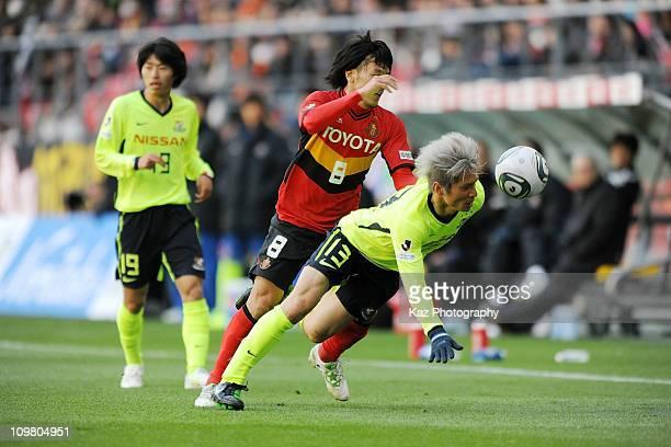 Yuzo Kobayashi of Yokohama F Marinos and Jungo Fujimoto of Nagoya Grampus compete for the ball during JLeague match between Nagoya Grampus and...