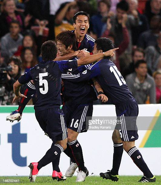 Yuzo Kurihara of Japan celebrates after scoring a goal during the FIFA World Cup Asian Qualifier match between the Australian Socceroos and Japan at...