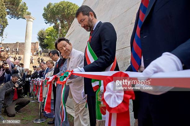 Yuzo Yagi Chairman Chief Executive Officer and President of Yagi Tsusho Limited stands with former with the mayor of Rome Ignazio Marino to cut a...