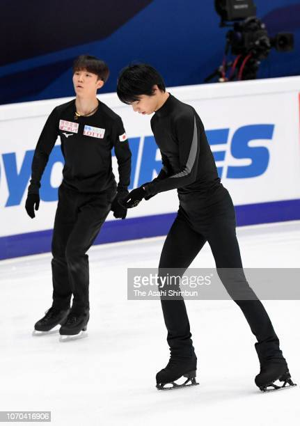 Yuzuru Hanyu and Kazuki Tomono of Japan are seen during a practice session ahead of the ISU Grand Prix of Figure Skating Rostelecom Cup at Megasport...