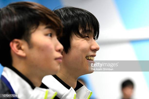 Yuzuru Hanyu and Kazuki Tomono of Japan attend the draw ahead of the ISU Grand Prix of Figure Skating Rostelecom Cup at Megasport Arena on November...