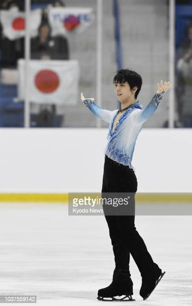 Yuzuru Hanyu of Japan acknowledges the audience after performing in the men's short program at the Autumn Classic International in Oakville Canada on...
