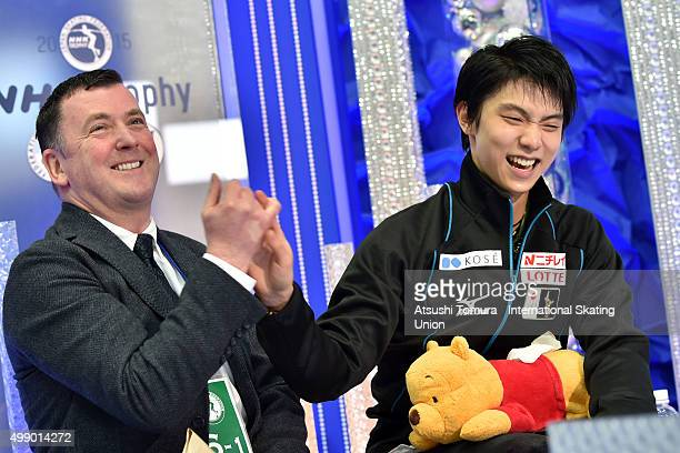 Yuzuru Hanyu of Japan and his coach Brian Orser celebrate after winning the NHK Trophy ISU Grand Prix of Figure Skating 2015 at the Big Hat on...