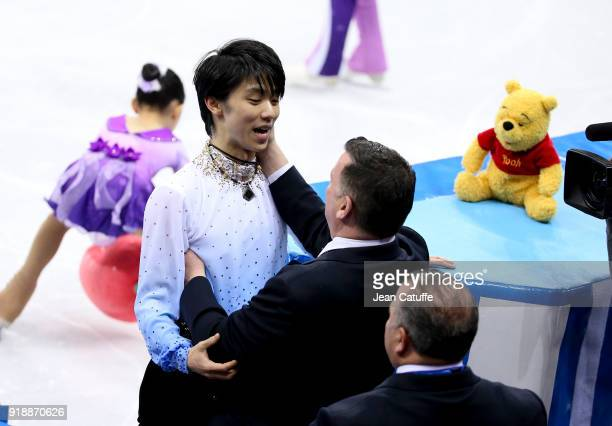 Yuzuru Hanyu of Japan and his coach Brian Orser following the Figure Skating Men Short Program on day seven of the PyeongChang 2018 Winter Olympic...