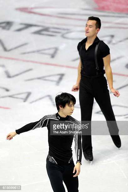 Yuzuru Hanyu of Japan and Patric Chan of Canada are seen during a practice session prior to the Men's Singles Short Program during day one of the...