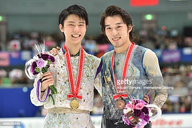 Yuzuru Hanyu of Japan and Takahito Mura of Japan pose with medals during the day two of the NHK Trophy ISU Grand Prix of Figure Skating 2015 at the...