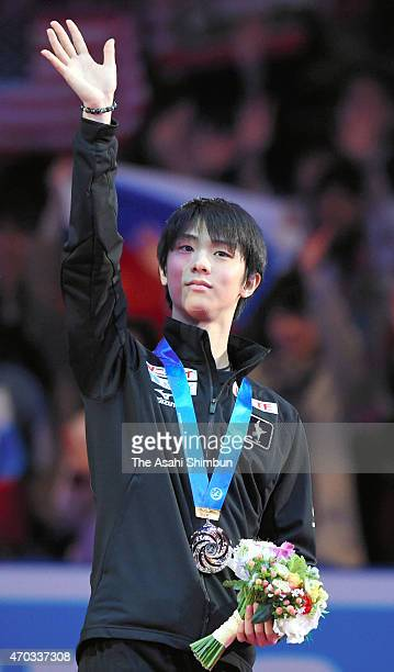 Yuzuru Hanyu of Japan applauds the fans after the award ceremony during the day three of the ISU World Team Trophy at Yoyogi National Gymnasium on...