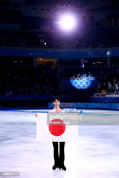 Yuzuru Hanyu of Japan celebrates after winning the gold medal in the Figure Skating Men's Free Skating on day seven of the Sochi 2014 Winter Olympics...