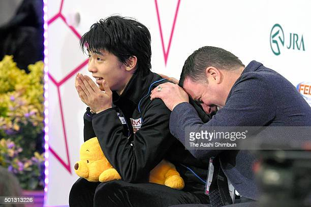 Yuzuru Hanyu of Japan celebrates his score with his coach Brian Orser at the kiss and cry after competing in the Men's Free Skating during day three...