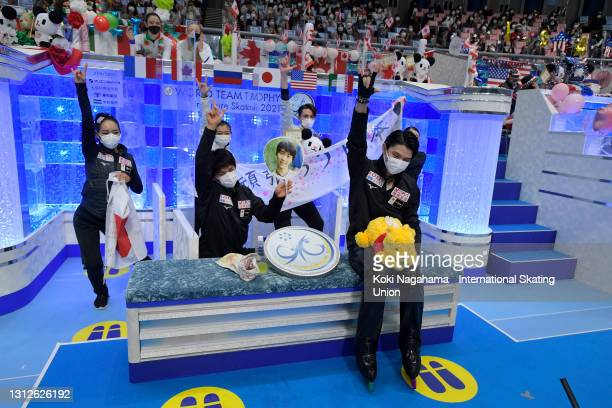 Yuzuru Hanyu of Japan celebrates with his team mates as his score is announced after competing in the Men's Single Short Program on day one of ISU...