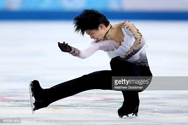 Yuzuru Hanyu of Japan competes during the Figure Skating Men's Free Skating on day seven of the Sochi 2014 Winter Olympics at Iceberg Skating Palace...