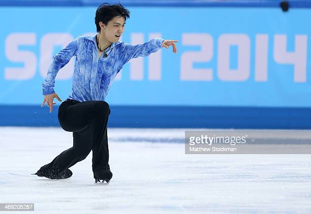 Yuzuru Hanyu of Japan competes during the Men's Figure Skating Short Program on day 6 of the Sochi 2014 Winter Olympics at the at Iceberg Skating...