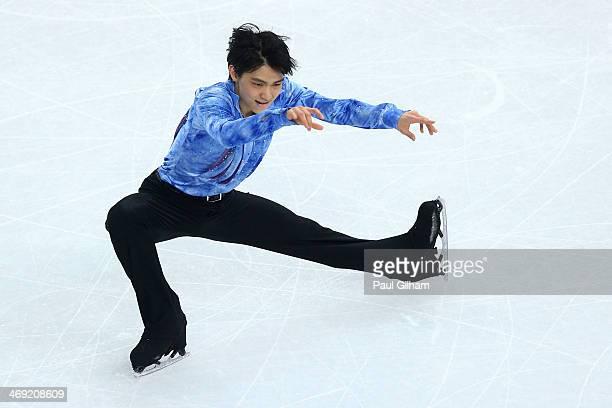 Yuzuru Hanyu of Japan competes during the Men's Figure Skating Short Program on day 6 of the Sochi 2014 Winter Olympics at the at Iceberg Skating...