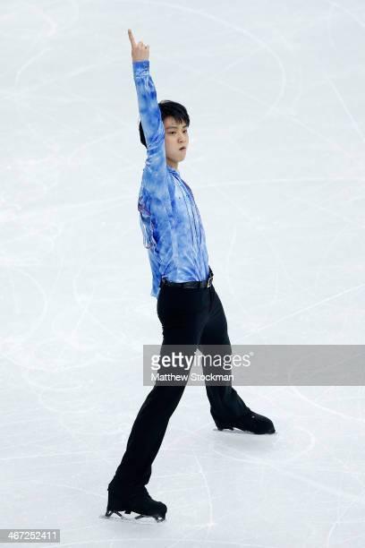 Yuzuru Hanyu of Japan competes in the Figure Skating Men's Short Program during the Sochi 2014 Winter Olympics at Iceberg Skating Palace on February...