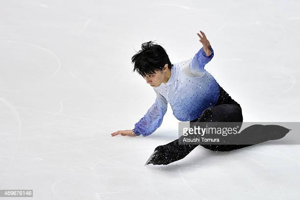 Yuzuru Hanyu of Japan falls while competing in the Men Short Program during day one of ISU Grand Prix of Figure Skating 2014/2015 NHK Trophy at the...