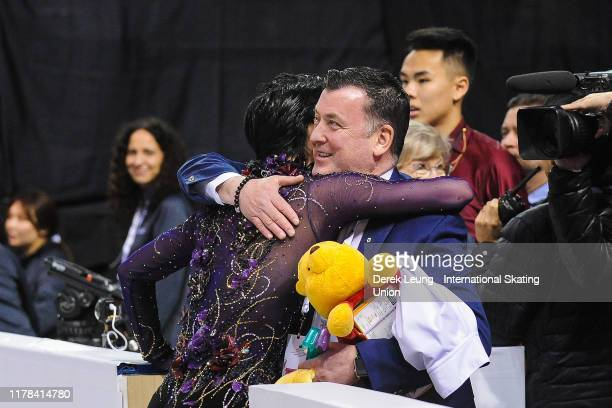 Yuzuru Hanyu of Japan hugs his coach before performing in the mens free skating placing first with a score of 21299 during the ISU Grand Prix of...