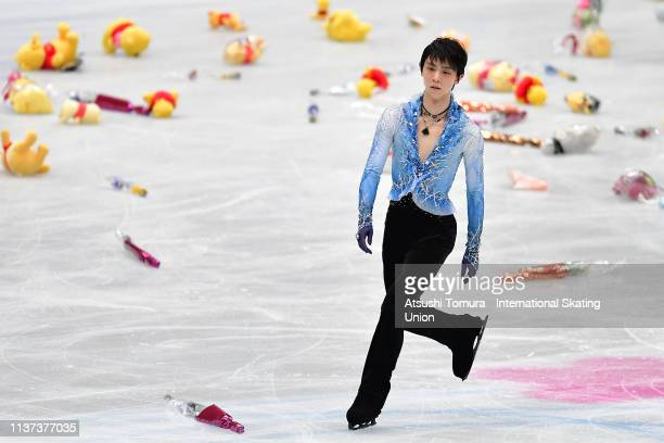 Yuzuru Hanyu of Japan is surrounded by WinniethePooh toys after he competed in the Men's short program during day 2 of the ISU World Figure Skating...