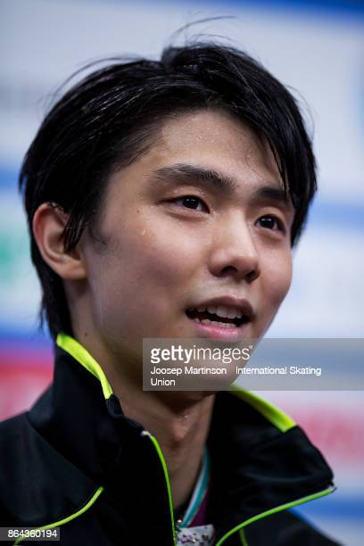 Yuzuru Hanyu of Japan looks on at the kiss and cry in the Men's Free Skating during day two of the ISU Grand Prix of Figure Skating Rostelecom Cup at...