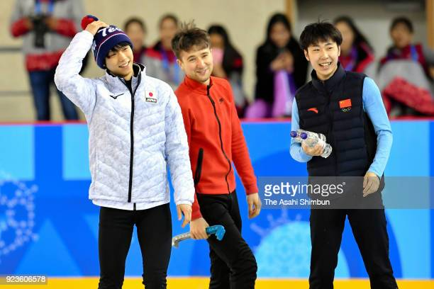 Yuzuru Hanyu of Japan Misha Ge of Uzbekistan and Jin Boyang of China share a lungh during a practice session ahead of the Figure Skating Gala...