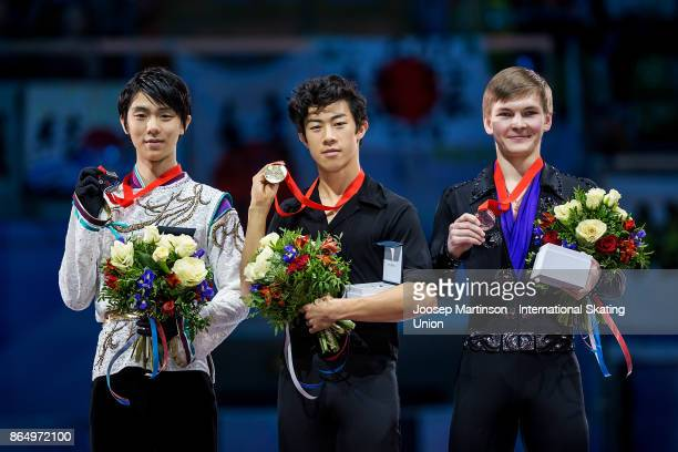 Yuzuru Hanyu of Japan Nathan Chen of the United States and Mikhail Kolyada of Russia pose in the Men's medal ceremony during day three of the ISU...