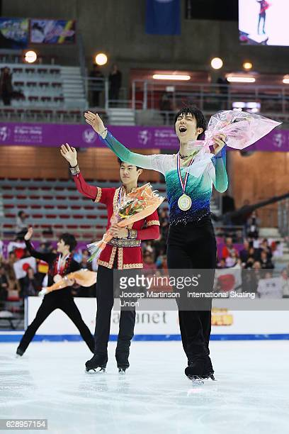 Yuzuru Hanyu of Japan, Nathan Chen of United States and Shoma Uno of Japan cheer after Senior Men's medal ceremony on day three of the ISU Junior and...