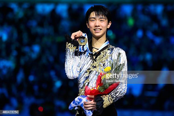 Yuzuru Hanyu of Japan pose for the media during the medals ceremony during day three of the ISU Grand Prix of Figure Skating Final 2014/2015 at...