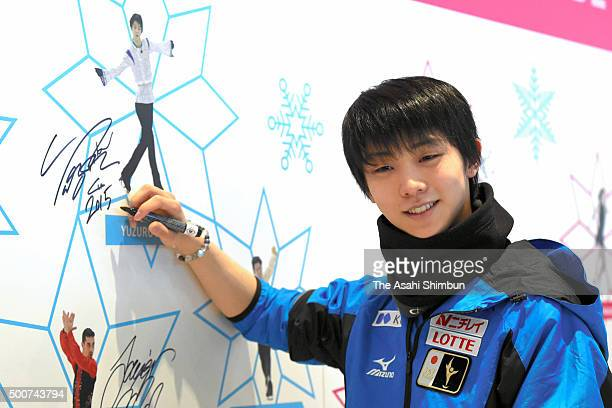 Yuzuru Hanyu of Japan poses for photographs after signing autograph ahead of the ISU Junior Senior Grand Prix of Figure Skating Final at the...