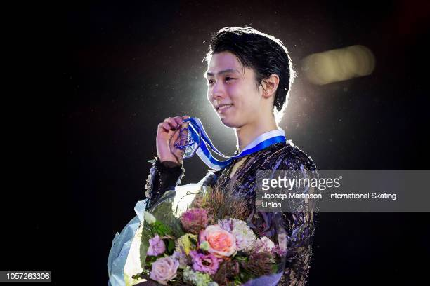 Yuzuru Hanyu of Japan poses in the Men's medal ceremony during day three of the ISU Grand Prix of Figure Skating at the Helsinki Arena on November 4...