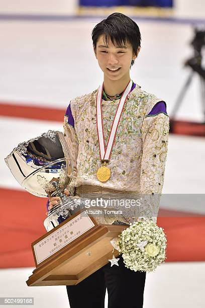 Yuzuru Hanyu of Japan poses with his medal during the day two of the 2015 Japan Figure Skating Championships at the Makomanai Ice Arena on December...