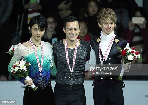 Yuzuru Hanyu of Japan poses with his silver medal and Patrick Chan of Canada poses with his gold medal and Kevin Reynolds of Canada poses with his...