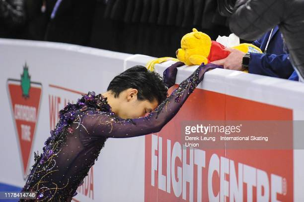 Yuzuru Hanyu of Japan prepares himself before performing in the mens free skating placing first with a score of 21299 during the ISU Grand Prix of...
