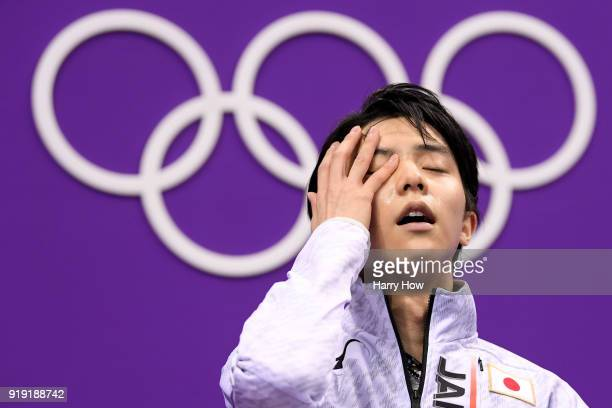Yuzuru Hanyu of Japan reacts after competing during the Men's Single Free Program on day eight of the PyeongChang 2018 Winter Olympic Games at...