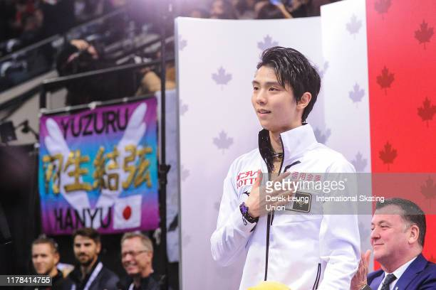 Yuzuru Hanyu of Japan reacts after seeing his score in the mens free skating placing first with a score of 21299 during the ISU Grand Prix of Figure...