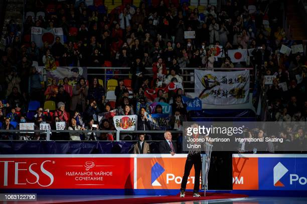 Yuzuru Hanyu of Japan screams to the crowd holding his crutches during Men's medal ceremony during day 3 of the ISU Grand Prix of Figure Skating...