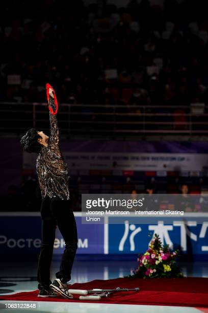 Yuzuru Hanyu of Japan shows his medal to the crowd next to his crutches during Men's medal ceremony during day 3 of the ISU Grand Prix of Figure...
