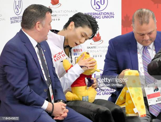 Yuzuru Hanyu of Japan waits for his score at the kiss cry after competing in the Men's Free Skating during the ISU Grand Prix of Figure Skating...