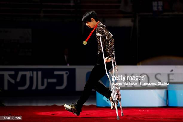 Yuzuru Hanyu of Japan walks on crutches during Men's medal ceremony during day 3 of the ISU Grand Prix of Figure Skating Rostelecom Cup 2018 at Arena...