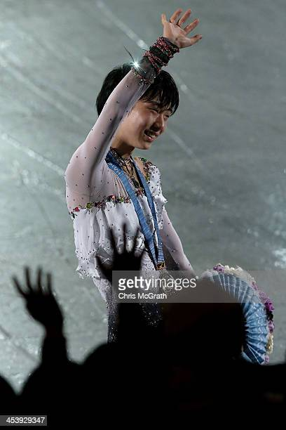 Yuzuru Hanyu of Japan waves to the crowd after receiving his gold medal during the victory ceremony for the Men's Free Skating Final on day two of...