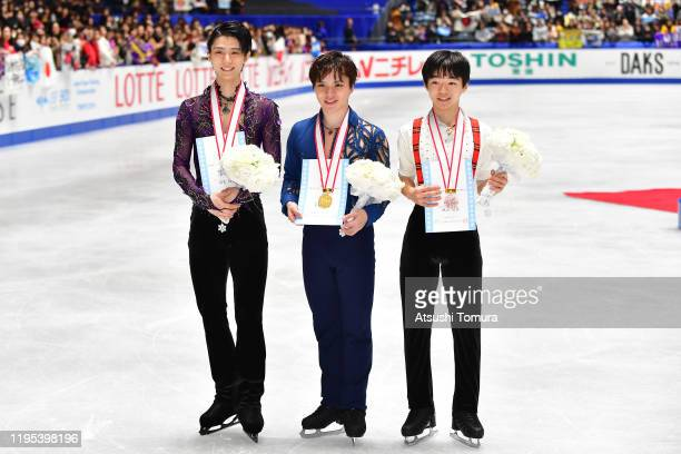 Yuzuru Hanyu , Shoma Uno and Yuma Kagiyama pose with their medals during day four of the 88th All Japan Figure Skating Championships at the Yoyogi...