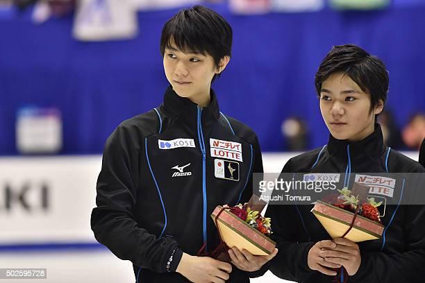 Yuzuru Hanyu Shoma Uno looks on during the 2015 Japan Figure Skating Championships at the Makomanai Ice Arena on December 27 2015 in Sapporo Japan