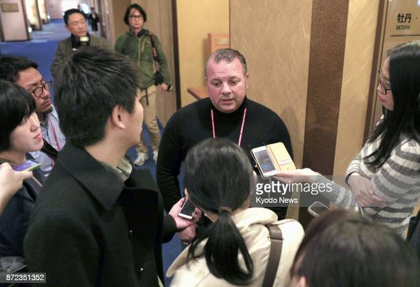 Yuzuru Hanyu's jump coach Ghislain Briand speaks to reporters in Osaka on Nov 10 to announce the Japanese figure skater will withdraw from the NHK...