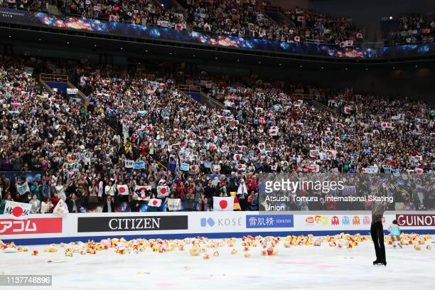 YuzuruHanyu of Japan applauds fans while fans throw in soft toys of WinniethePooh after competing in the Men Free Skating on day four of the 2019...