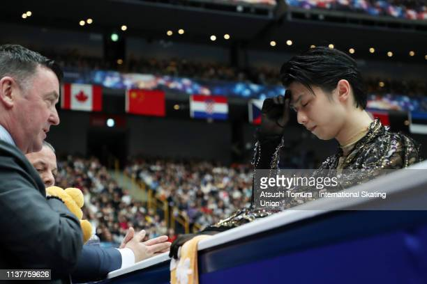 YuzuruHanyu of Japan talks with his coach Brian Orser prior to competing in the Men Free Skating on day four of the 2019 ISU World Figure Skating...