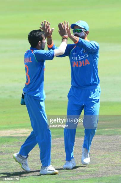 Yuzvendra Chahal and Virat Kohli of India celebrate the wicket of AB de Villiers of the Proteas during the 6th Momentum ODI match between South...
