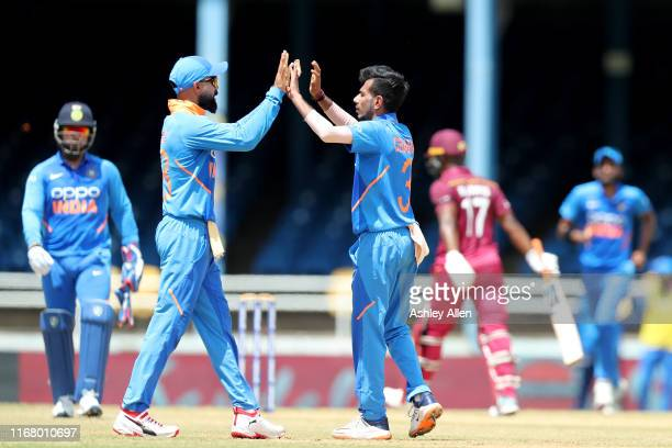 Yuzvendra Chahal and Virat Kohli of India celebrate the wicket of Evin Lewis of the West Indies during the third MyTeam11 ODI between the West Indies...