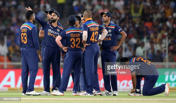 Yuzvendra Chahal of India celebrates after taking the wicket of Dawid Malan of England as Virat Kohli of India points towards the big screen review...