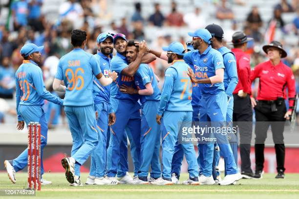 Yuzvendra Chahal of India celebrates the wicket of Mark Chapman of the Black Caps with Virat Kohli and his team during game two of the One Day...
