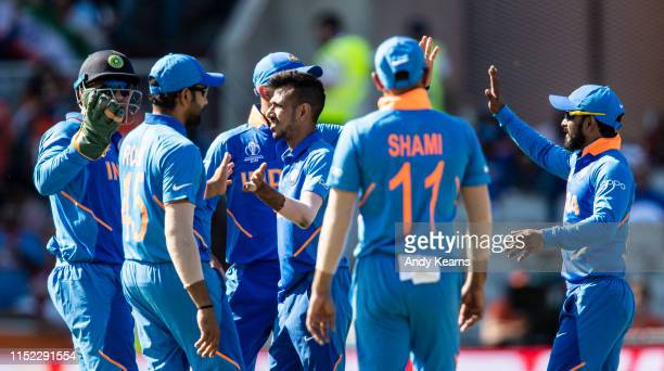 Yuzvendra Chahal of India celebrates with his team mates after taking the wicket of Jason Holder of West Indies during the Group Stage match of the...